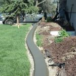 Gray slant style curbing in Lehi, Utah by Utah Valley Curb, photo 3